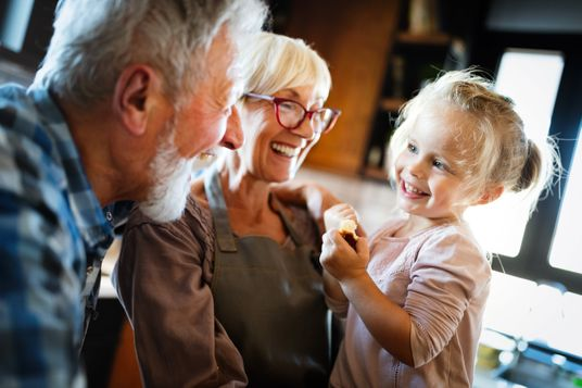 Happy granparents playing with a child
