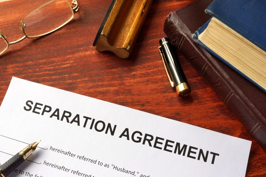 Signing a prenuptial agreement in a family lawyers office